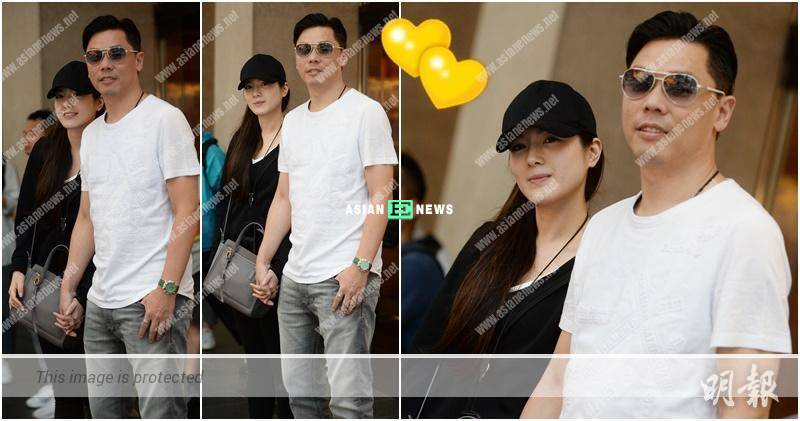 Christine Kuo and William Lok hold hands together tightly at the Central