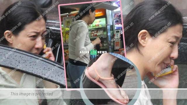 Elaine Ng looks troubled and buys a pack of cigarettes from convenience store