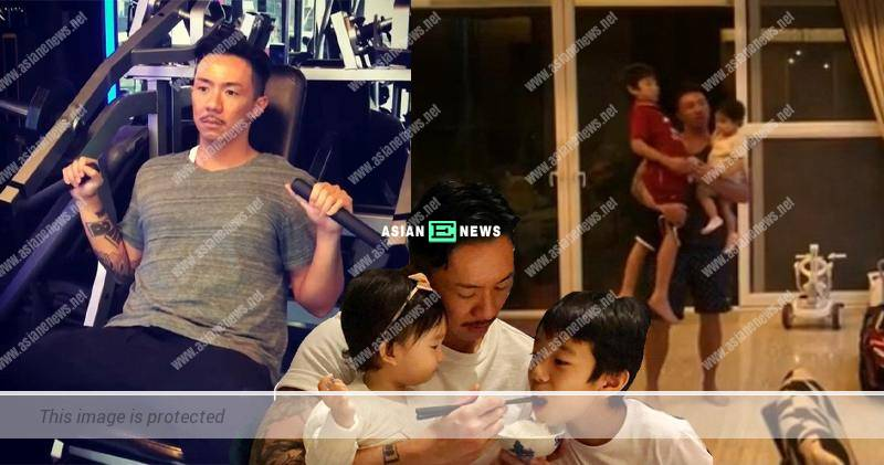 Muscular Louis Cheung carries his two children at the same time