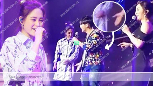 Gillian Chung complains a male fan tries to hold her hand