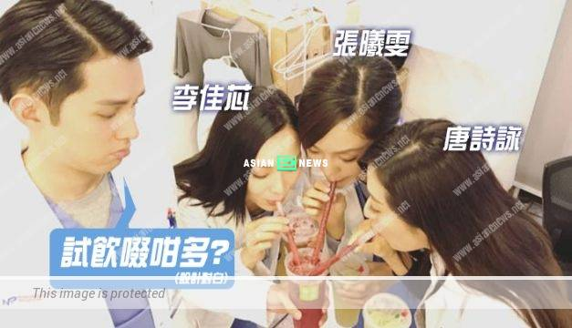 Helpless Matthew Ho holds the cup for Natalie Tong and Ali Lee to drink