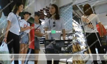 Karena Ng wears a white top revealing her bra at the supermarket