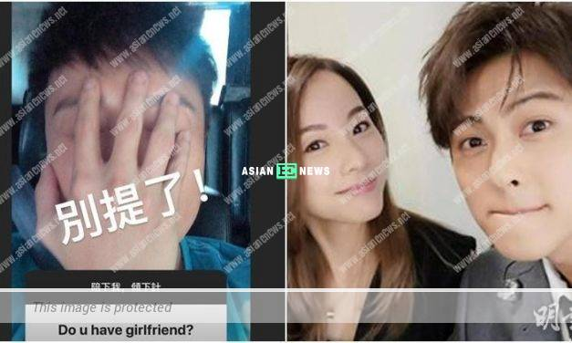 Any girlfriend? Alex Fong uses his hand to block his face