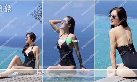 Natalie Tong looks sexy in her black colour swimsuit