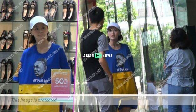 Rebecca Zhu goes for window shopping alone