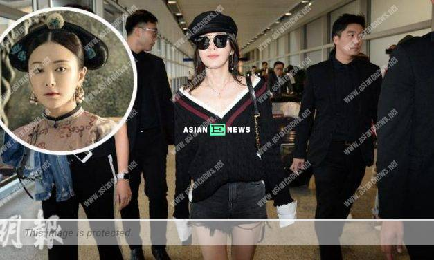 """""""Empress"""" Qin Lan arrives in Hong Kong with 8 security guards escorting her"""
