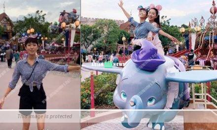 Sisley Choi and Jeannie Chan ride on Dumbo at the theme park