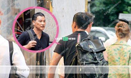 Simon Yam smokes quickly in the back alley