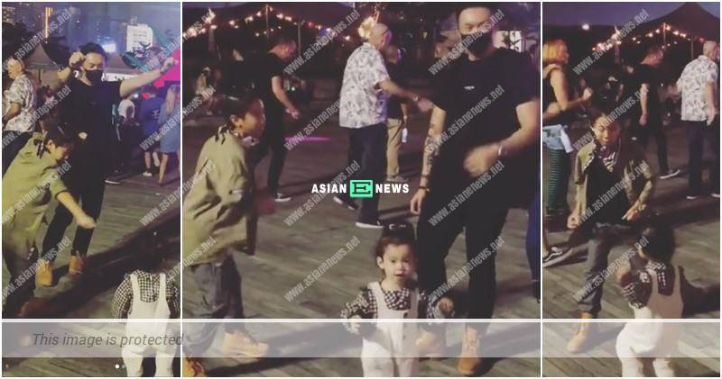 Louis Cheung and his family dance together during a musical festival