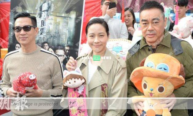 Nick Cheung and Sean Lau promote their new film at flowers market