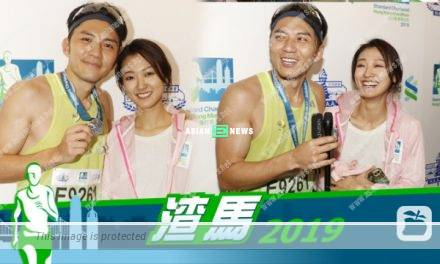 Bowie Cheung roots for Benjamin Yuen when running for half marathon
