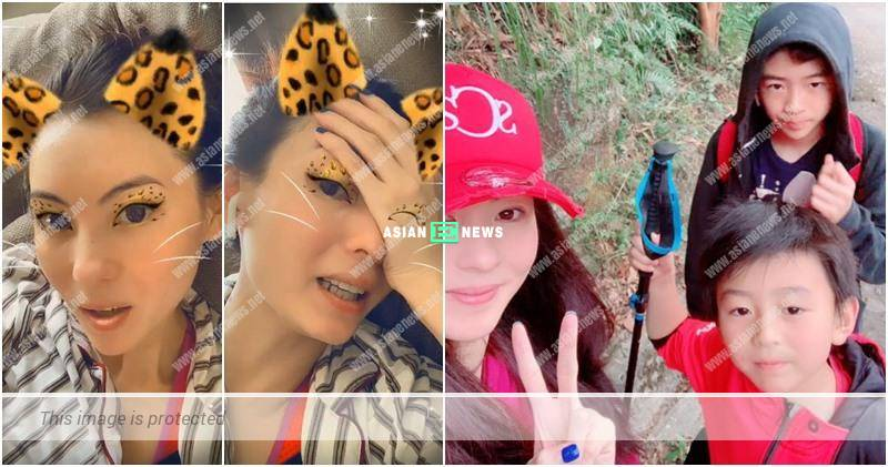 Is Cecilia Cheung's son, Quintus playing with her mobile phone?