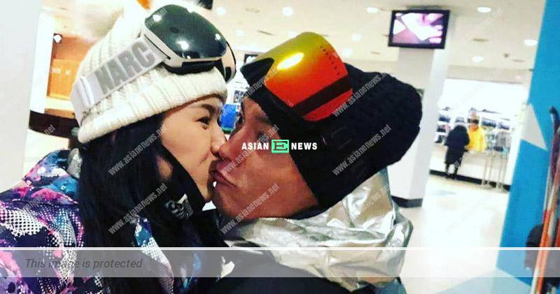 Loving couple, Matt Yeung and Lisa Chong show photo of themselves kissing