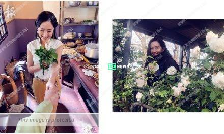 Natalie Tong receives a bouquet of flowers and smiles sweetly