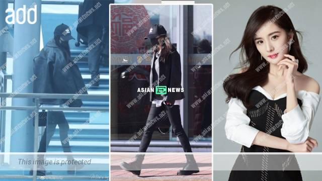 Yang Mi wore all black and behaved mysteriously at the airport