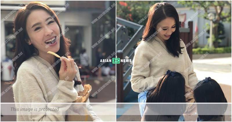 Gigi Lai feels happy by eating chips with her daughters