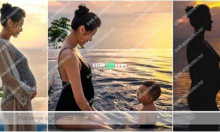 Taking a photo album? Myolie Wu enjoys the swim together with her son