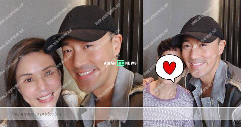 Carman Lee takes photo with Raymond Lam: I assume he is my fan