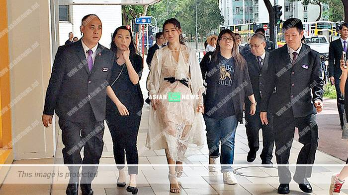 Priscilla Wong looks domineering when escorted by 10 security guards