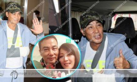 Simon Yam's arm is covered in bandage after discharging from the hospital for a week