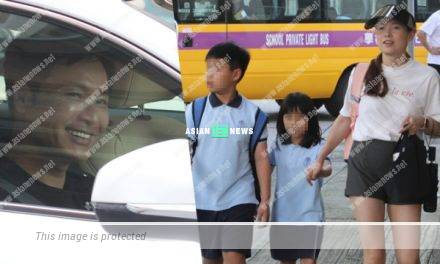 Roger Kwok and his wife, Cindy Au fetched their children from the school
