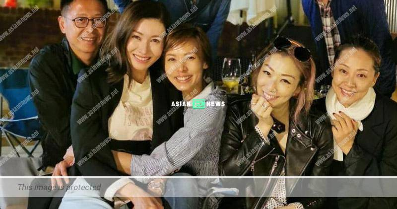 Michelle Reis and her husband accompany Sammi Cheng to England
