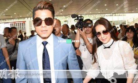 Aaron Kwok and his wife, Moka Fang resembled a sweet couple at the racecourse