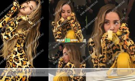 Jolin Tsai wore a yellow leopard outfit and pretended banana as telephone