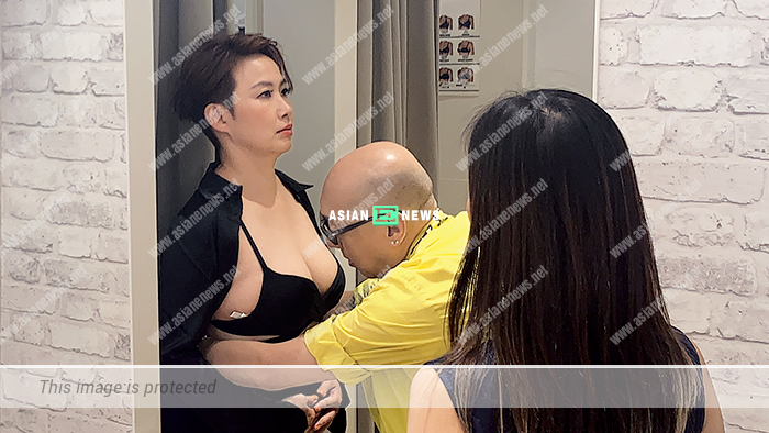 48-year-old Karen Tong wears a bra top revealing her 36E breast size