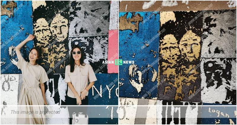 Priscilla Wong drew Natalie Tong and her portraits on a recycling wall