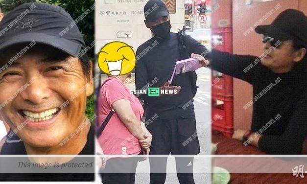 Chow Yun Fat is dressed in black outfit and recognised by his fan