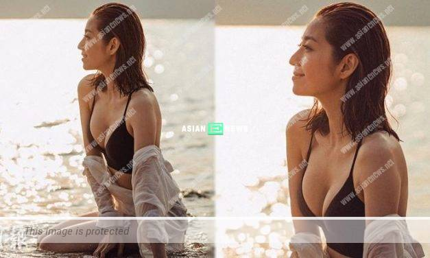 Yoyo Chen wore black bikini revealing her cleavage at the sea