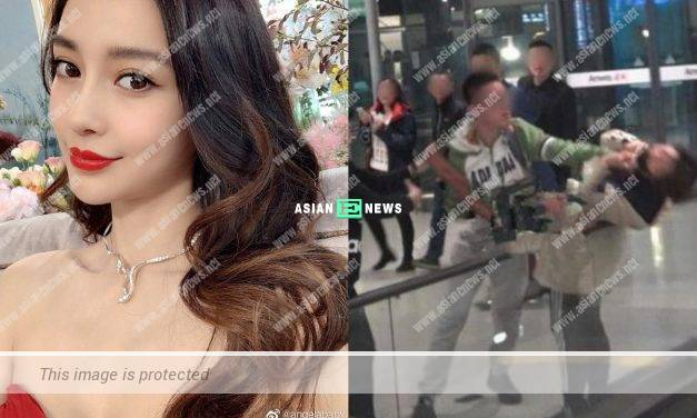 Bravo to Angelababy for protecting her fan in an airport