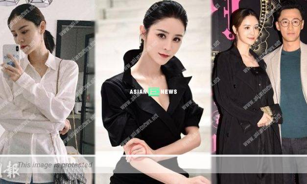 Is Carina Zhang wearing a wedding ring on her left ring finger?