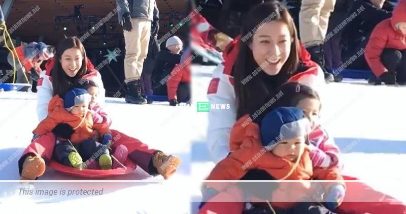 Linda Chung shouted while playing snow together with her children