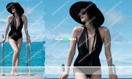 Myolie Wu shows her fit body figure by wearing a black swimsuit