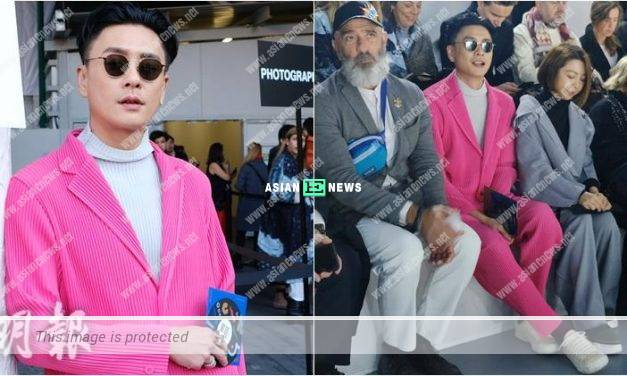 Bosco Wong wore a striking pink suit at a fashion show in France