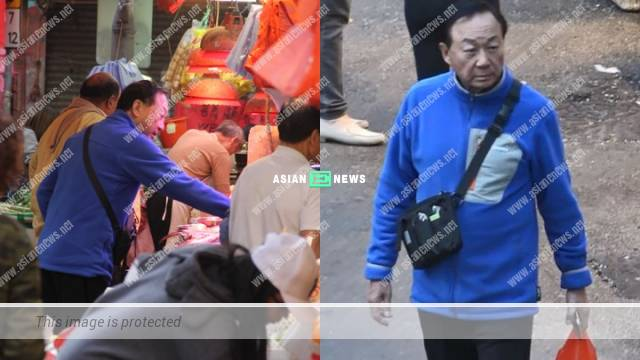 77-year-old Michael Hui bought seafood and took photo with the assistant