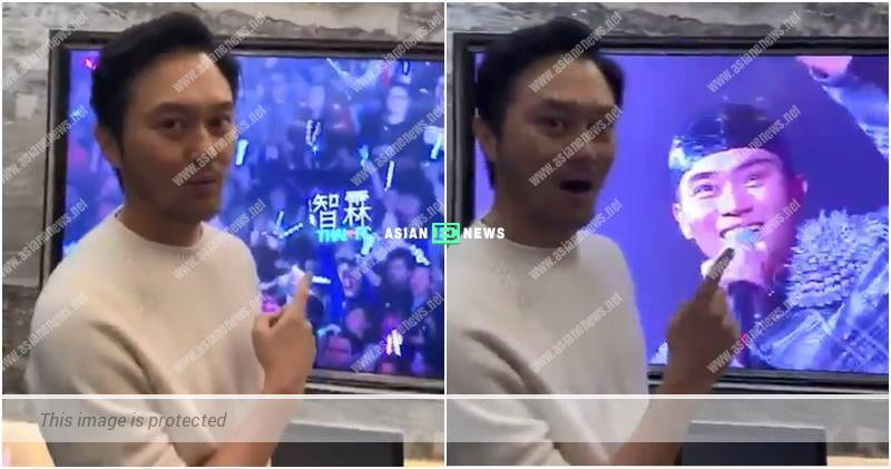 Julian Cheung watches his concert on television