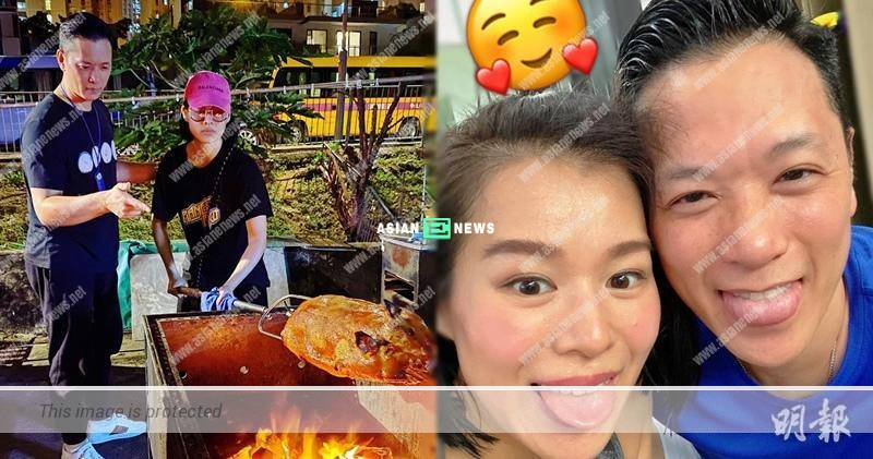 Philip Lee guides Myolie Wu when barbecuing suckling pig