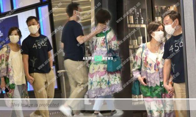 Good husband Wayne Lai holds his wife's hands tightly at the shopping mall