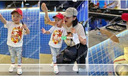 Myolie Wu's son Brendan gets a live king prawn at a shrimp farm
