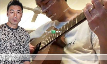 Andy Hui shows his wedding ring while playing guitar