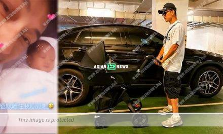 Joel Chan takes photo of his son when he is sleeping