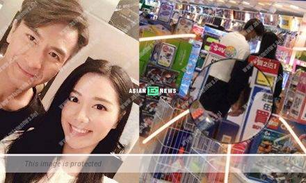 Kenneth Ma and Roxanne Tong hold hands tightly at a toys store