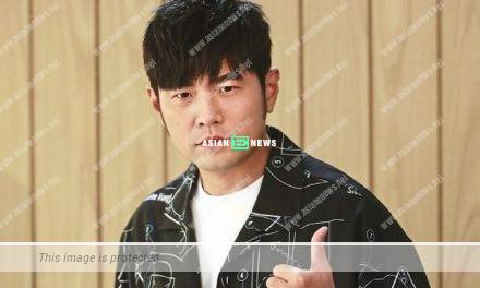 Taiwanese singer Jay Chou shows his old school photo