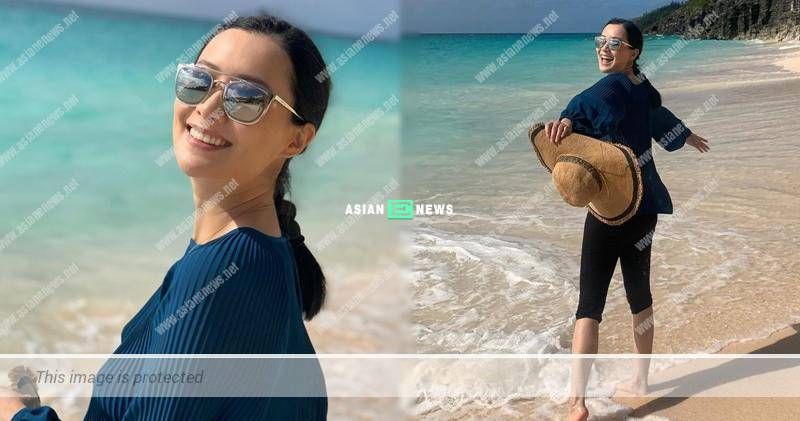 Fala Chen smiles sweetly as her husband acts as her photographer
