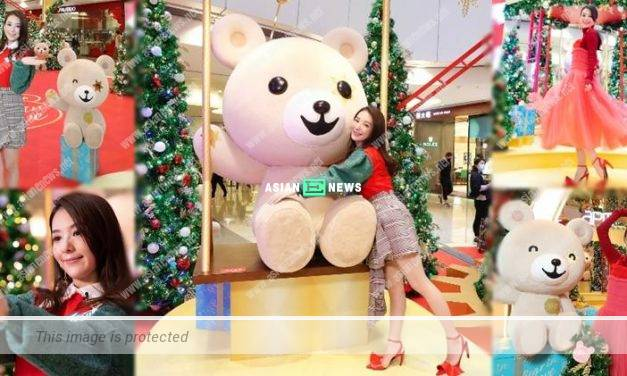Moka Fang is reminded of her daughters when taking photos with teddy bear