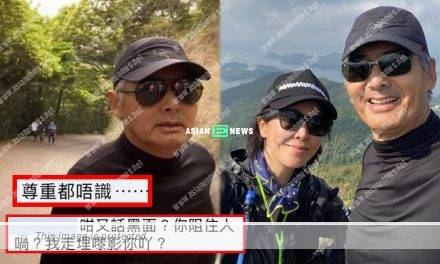 Chow Yun Fat looks annoyed when a hiker takes photo of him