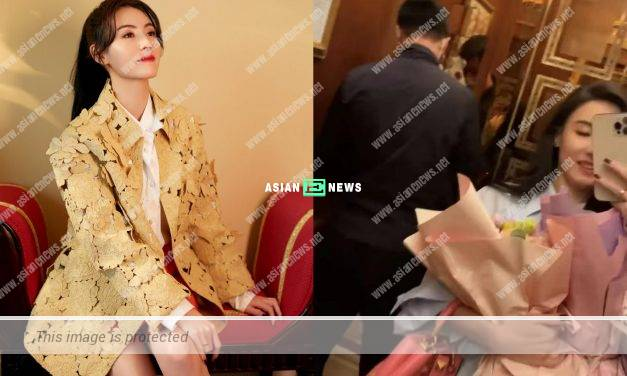 Fan or admirer? Cecilia Cheung wears a gold ring and receives a bouquet of flowers